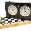 Old chess clock on chessboard — Foto de Stock