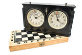 Old chess clock on chessboard — Stock Photo
