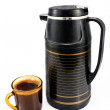 Стоковое фото: Cup of coffee with black thermos