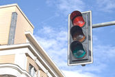 Traffic lights against sky backgrounds — Stock Photo
