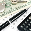 Pen, House key, Calculator and Interest rates on bank loans - Foto Stock