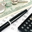 Pen, House key, Calculator and Interest rates on bank loans - Stock Photo