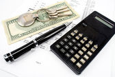 Pen, House key, Calculator and Interest rates on bank loans — Stock Photo