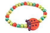 Wooden beads bracelet with ladybug — Stock Photo