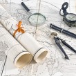 Stock Photo: Old Maps in rolls with magnifier and compass