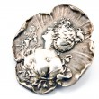 Antique silver brooch with woman's profile — Stock Photo