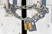 Padlock with chain on old door — Stock Photo