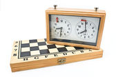 Chess clock on chessboard — Stock Photo