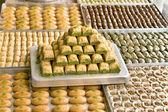 Turkish sweets on plates — Stock Photo