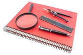 Notebook with drawing compass, ruler, pen and magnifier — Stock Photo