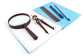 Wooden pencil, pen, drawing compass, magnifier and ruler on spira — Stock Photo