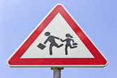 Traffic road school sign over blue sky — Stock Photo