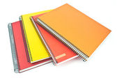 Stack of colorful spiral notebooks — Stock Photo