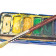 Closeup of Watercolor paints and paintbrush on white — Stock Photo