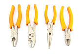 Four yellow pliers isolated on white — 图库照片