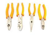 Four yellow pliers isolated on white — Stockfoto