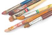 Used artist brushes on white — Stock Photo