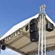 Stock Photo: Outdoor concert stage construction over sky