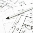 Stock Photo: House plan blueprints with drawing pencil