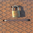 Stock Photo: Old padlock on rusty iron plate