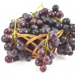 Dark grapes in a basket on white — Stock Photo