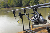 Fishing rod and reel under water — Stockfoto