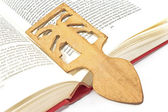 Wooden bookmark in a book — Stock Photo