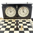 Old chess clock and chessboard on white — Stok fotoğraf #39106161