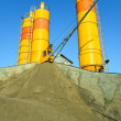 Yellow concrete silos over blue sky — Stock Photo