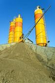 Yellow concrete silos over blue sky — Stock Photo