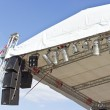 Outdoor concert stage roof construction with speakers over sky — Stock Photo #40801519