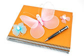 Stack of spiral notebooks with butterflies and pen isolated on — Stock Photo
