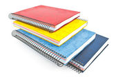 Stack of colorful spiral notebooks isolated on white — Stock Photo