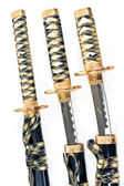 Three Japanese samurai katana swords over white — Stock Photo