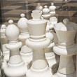 Big black and white figures for chess game — Stock Photo