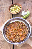 Minced meat sauce with vegetables cooked in pan with pasta — Stock Photo