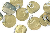 Tin can lids with opener on white — Stock Photo