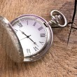 Silver pocket watch on wooden background — Stock Photo #48132943