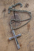 Silver christian cross necklace with  diamonds on wooden backgro — Foto de Stock