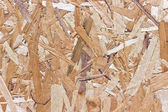 Wood chipboard yellow texture as background — Stock Photo