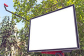 Blank billboard in a park with blue sky — Stock Photo