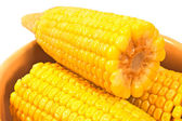 Close up of boiled corn in ceramic bowl on white  — Stock Photo