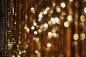 Golden chain round bokeh with black background — Stock Photo