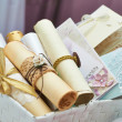 Foto de Stock  : Wedding invitation scrolls in the bucket