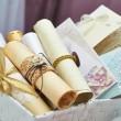 Wedding invitation scrolls in the bucket — Stock Photo