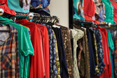 Designer clothes lined up in store — Stock Photo