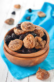 Dried figs and plums in the bowl — Stock Photo