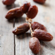 Sweet date on the wooden table — Stock Photo