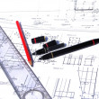 Ruler and pencil on architectural drawings - Stock Photo