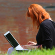Red-headed woman with laptop — Stock Photo